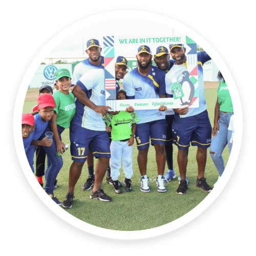The Glacial Cares team taking picture with a Curacao sports team