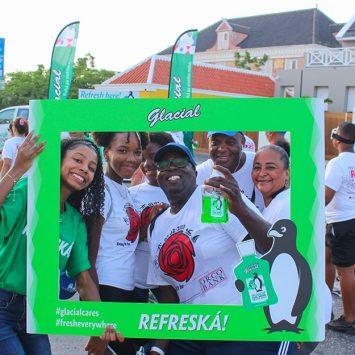 The Alcolado Glacial cares team smiling holding a photo frame.